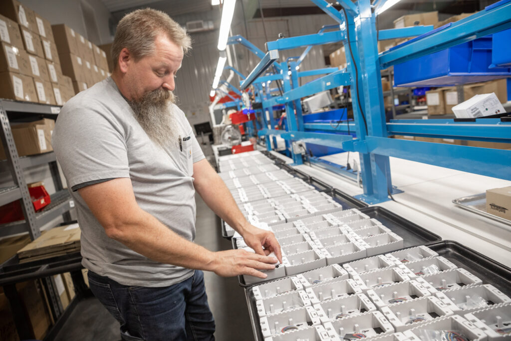 Man assembling parts at Macurco gas detection